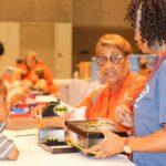 SLA Members Shoe Giving Urban Expo